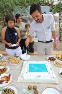 Pedro cutting the cake at the 15th anniversary of Associação Transumância e Natureza (ATN).