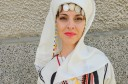 Young woman in traditional clothing in Kondovo village, Rhodope Mountains, Bulgaria.