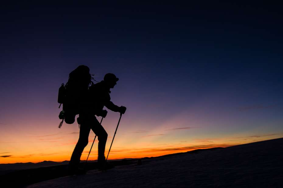 Hiker on Majella's altitude plateau at sunset, Central Apennines, Italy