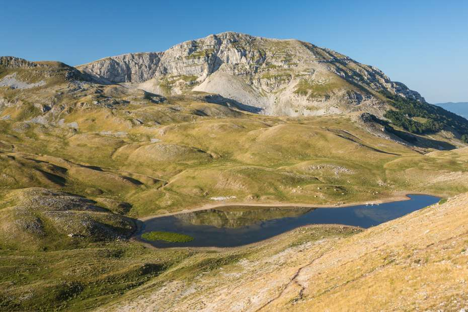View over the Duchessa Lake in Duchessa Mountains Nature Reserve, Central Apennines, Italy
