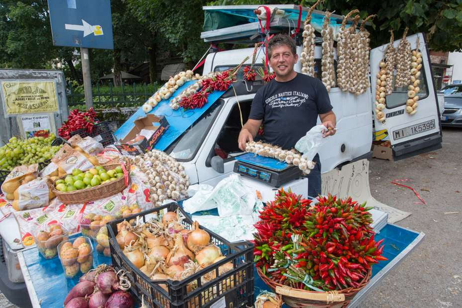 "Street vendor of vegetables, peppers and local ""red"" garlic, Central Apennines, Italy"