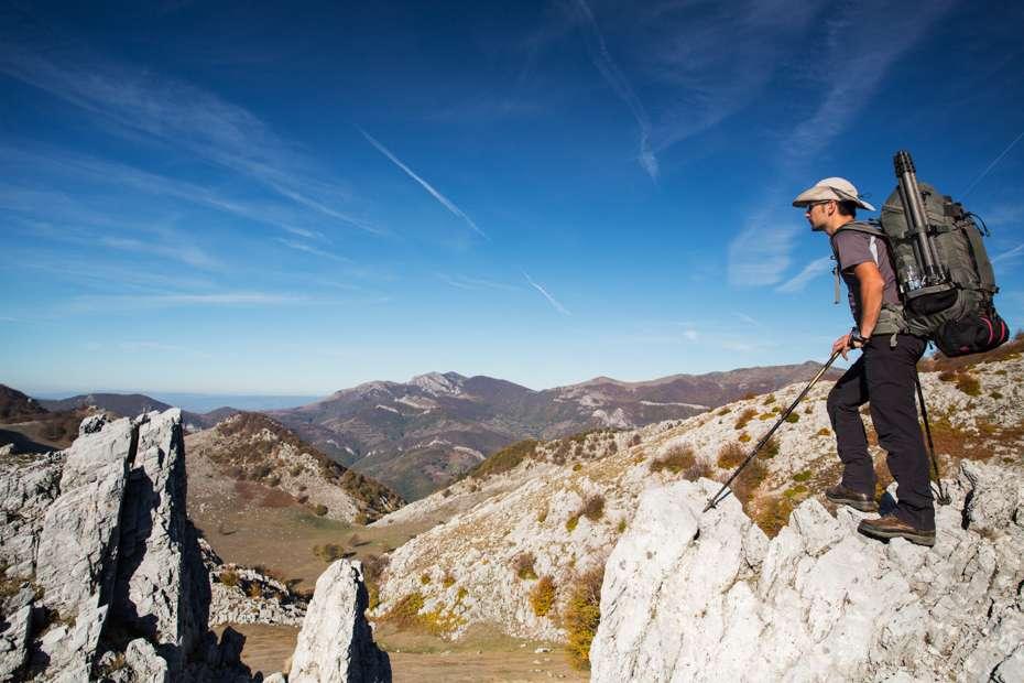 Hiker on limestone ridge in Mehedinti Plateau Geopark, Romania