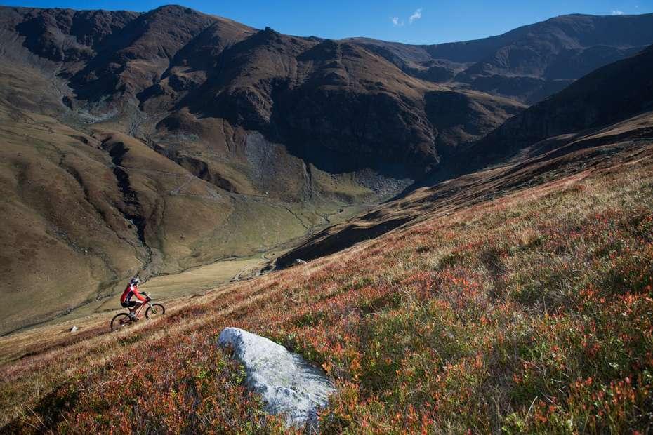 Mountain biker riding the slopes of the Tarcu Mountains, Southern Carpathians, Romania