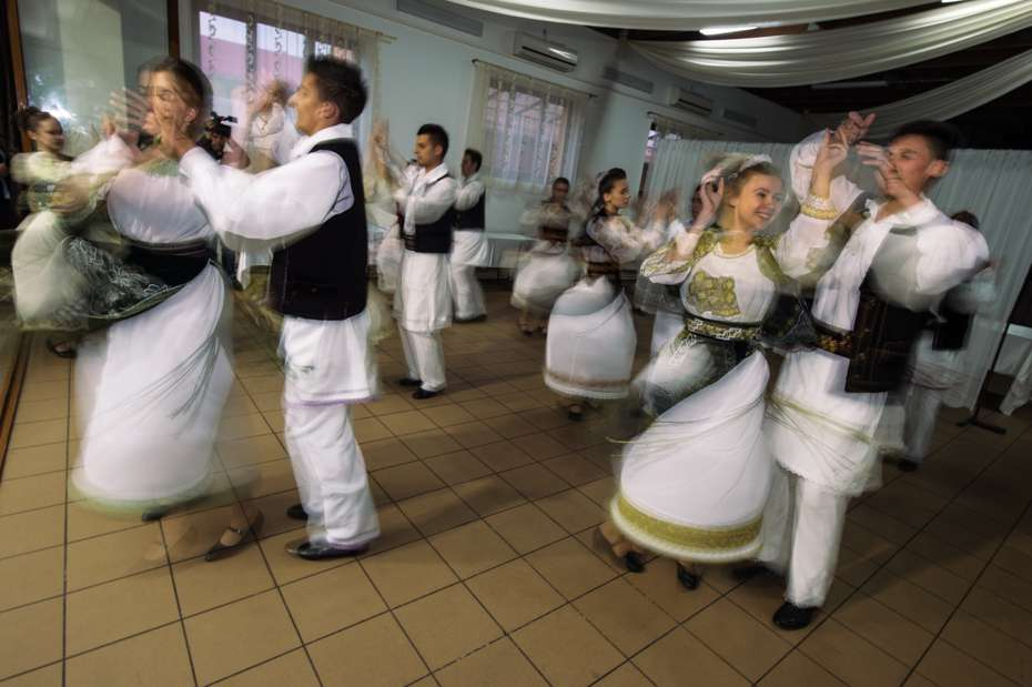 Local folk dancers at the bison release party, Southern Carpathians, Romania